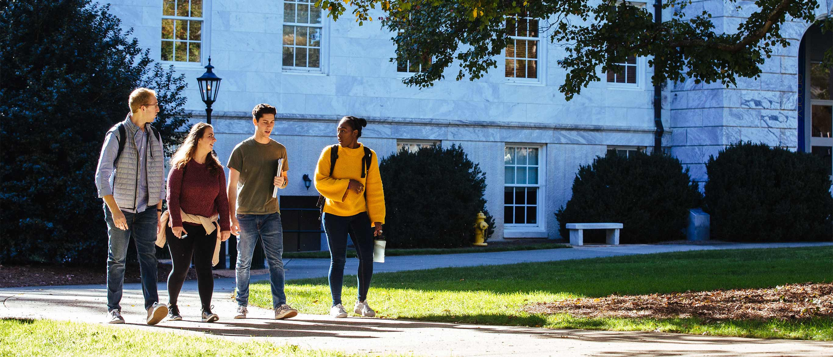 four students walking on the Quad on Emory's Atlanta campus